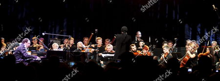 Canadian Pianist Producer and Songwriter Chilly Gonzales (l) with Aukso Tychy Chamber Orchestra Perform During a Concert at the Tauron New Music Festival in Katowice 23 August 2012 Poland Katowice