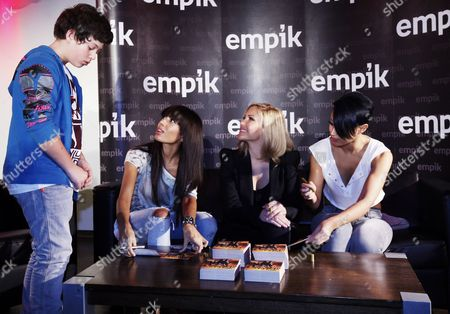 Members of English Band 'Sugababes' (2l-r) Jade Ewen Heidi Range and Amelle Berrabaha Sign Autographs As They Meet a Fan (l) in Warsaw Poland 26 February 2010 the Sugababes Are in Poland to Promote Their New Album 'Sweet 7' Poland Warsaw