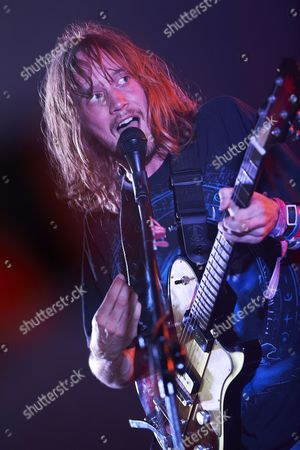 Stock Photo of Vocalist and Guitarist of British Folk Rock Band Dry the River Peter Liddle Performs on Stage During the Band's Concert at the Opener Festival in Gdynia Poland 05 July 2012 Poland Gdynia