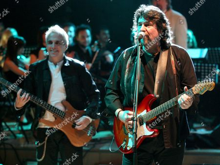 Phil Bates (r) and Glen Burtnik (l) of the British Rock Group 'Electric Light Orchestra' Perform on Stage During Their Concert at the Cracow Auditorium Maximum in Cracow Poland 29 November 2009 Poland Cracow