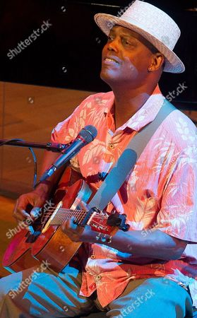 Us Acoustic Blues Singer and Songwriter Eric Bibb Performs on Stage During His Concert at the Rawa Blues Festival in Katowice Poland 10 October 2014 Poland Katowice