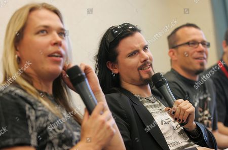 Members of Finnish Cello Rock Band Apocalyptica (l-r) Eicca Toppinen (l) Perttu Kivilaakso (c) and Paavo Lotjonen (r) During a Press Conference Before an Evening Concert in the Freedom Park at the Museum of Warsaw's Uprising in Warsaw on 27 July 2008 the Concert Forms Part of a Programme of Activities on the Occasion of the 64th Anniversary of the World War Ii Struggle Warsaw Uprising Poland Warsaw