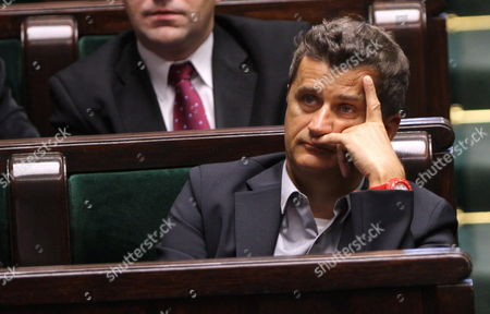 Leader of Palikot Movement Janusz Palikot Listens During a Debate After Pm's Report on the Eu Future Presented in Sejm (lower House of Poland's Parliament) in Warsaw Poland 15 December 2011 Poland Warsaw