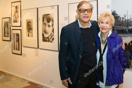 Us Photographer Pat York and Her Husband Michael (l) Pose in Front of Photographs Displayed During the Exhibition 'Covered-uncovered' at the Cultural Center Katowice Poland 19 August 2014 the Exhibition Runs Until 08 September Poland Katowice