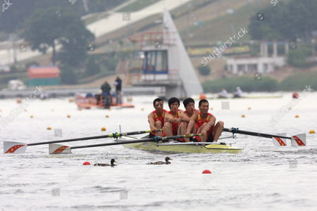 Stock Image of Xingbo Zhang Linquan Zhao Kang Guo and Kai Song of China in Action During the Mens Coxless Four Preliminary Race at the Rowing Qualification Regatta For the Olympic Games Poznan Poland 16 June 2008 Poland Poznan