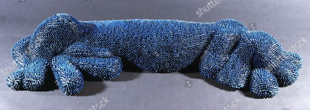 Life-size sculpture of a sleeping dog scuplture made entirely from crayons