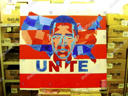 This is the first stage in Herb's portrait of US President Elect Barack Obama. In this shot, Herb has painted the image, onto which he then had to apply the thousands of crayons, seen in boxes on either side