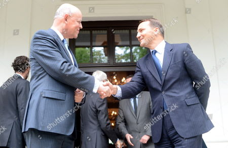 Polish Foreign Minister Radoslaw Sikorski (r) Shakes Hands with Foreign Minister of the Netherlands Uri Rosenthal (l) During the Conference in Warsaw Poland 17 May 2012 Poland Warsaw