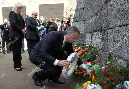 Slovak Prime Minister Iveta Radicova (l) and Slovak Minister of Justice Jan Figel (r) Lay Flowers For Victims of the Former Nazi-german Concentration Camp Kl Auschwitz During Their Visit in Oswiecim Poland 23 March 2012 Poland Oswiecim