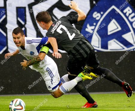 Jakub Kowalski (l) of Ruch Chorzow in Action Against Michael Jakobsen (r) of Esbjerg Fb During the Uefa Europa League Third Qualifiying Round First Leg Soccer Match Between Ruch Chorzow and Esbjerg Fb in Gliwice Poland 31 July 2014 Poland Gliwice