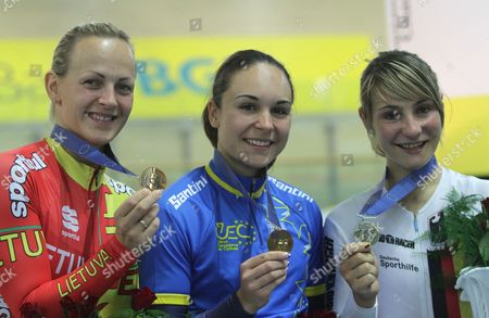 Sandie Clair (c) of France on the Podium After Winning Gold Medal the Women's Sprint Final at the European Elite Track Cycling Championships 2010 at Bgz Arena Velodrome in Pruszkow Poland 06 November 2010 Clair Won Ahead of Second Placed Kristina Vogel (r) of Germany and Third Placed Simona Krupeckaite (l) of Lithuania Poland Warsaw