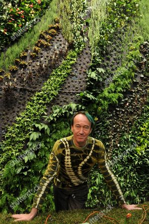 French Botanist and the Inventor of the Vertical Garden Patrick Blanc Poses in Front of His Vegetal Wall in a Shopping Mall in Gdansk Poland 17 March 2009 Vertical Garden is a Way to Grow Plants Without Any Soil While Plants Are Irrigated by Water Mixed with Mineral Salts and Vitamins Poland Gdansk