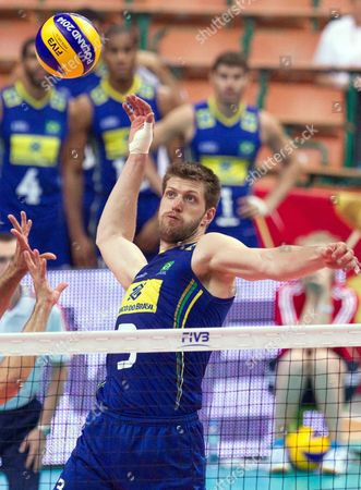 Eder Carbonera of Brazil Spikes the Ball During the Group B Match Between Brazil and South Korea For the Fivb Volleyball Men's World Championship Poland 2014 at the Spodek in Katowice Poland 06 September 2014 Poland Katowice