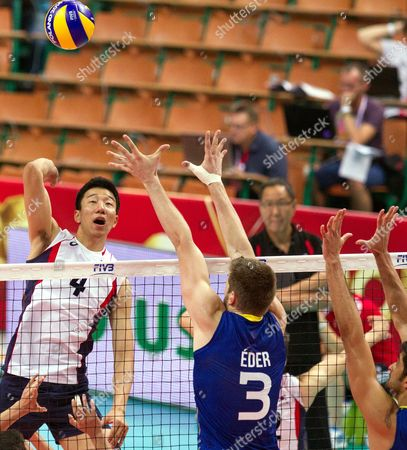 Yung-suk Shin (l) of South Korea Spikes the Ball Against Eder Carbonera (r) of Brazil During the Group B Match Between Brazil and South Korea For the Fivb Volleyball Men's World Championship Poland 2014 at the Spodek in Katowice Poland 06 September 2014 Poland Katowice