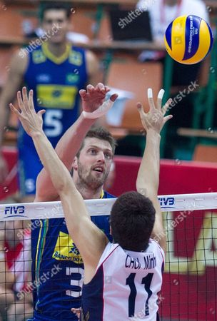 Eder Carbonera (l) of Brazil Spikes the Ball Against Min-ho Choi (r) of South Korea During the Group B Match Between Brazil and South Korea For the Fivb Volleyball Men's World Championship Poland 2014 at the Spodek in Katowice Poland 06 September 2014 Poland Katowice