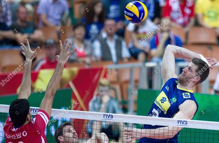 Eder Carbonera (l) of Brazil and Omar Agrebi (l) of Tunisia in Action During the Fivb Volleyball Men's World Championship Group B Match Between Tunisia and Brazil at the Spodek Arena in Katowice Poland 03 September 2014 Poland Katowice