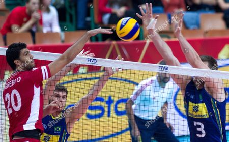 Eder Carbonera (r) of Brazil and Omar Agrebi (l) of Tunisia in Action During the Fivb Volleyball Men's World Championship Group B Match Between Tunisia and Brazil at the Spodek Arena in Katowice Poland 03 September 2014 Poland Katowice