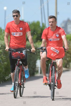 Polish National Soccer Team Players Robert Lewandowski (l) and Slawomir Peszko (r) Are Seen During Bike Trip in La Baule France 18 June 2016 Polish Footballers who Are Preparing For the Third Game in the Group Stage of Uefa Euro 2016 Tournament Are Having a Day Off Today France La Baule
