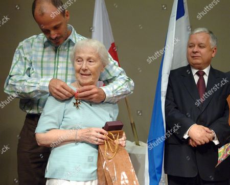 During His Official Visit to Israel Polish President Lech Kaczynski (r) Decorated Sara Batt (c) with the Officer's Cross of the Order of the Polonia Restituta Awarded to Her in Connection with the 62nd Anniversary of the Warsaw Rising in Jerusalem on Monday 11 September 2006 the Ceremony Took Place During the Opening of a Polish Exhibition in the Menachem Begin Centre in Jerusalem the Exhibition 'For Your Freedom and Ours' is Devoted to the Participation of Polish Citizens of Jewish Origin in the Polish Army Sara Batt Fought As a Liaison in the Warsaw Rising in 1944 Israel Jerusalem