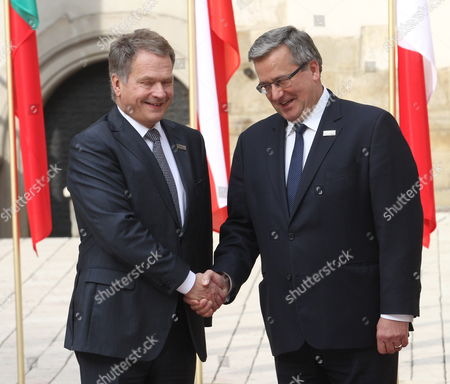 President of Poland Bronislaw Komorowski (r) Welcomes President of Finland Sauli Vainamo Niinisto (l) During a Welcome Ceremony of the Arraiolos Group Meeting at the Wawel Royal Castle in Cracow Poland 08 October 2013 on a First Day of the Arraiolos Group Meeting the Presidents Will Discuss Ways to Overcome the European Crisis and Transatlantic Relations Poland Cracow