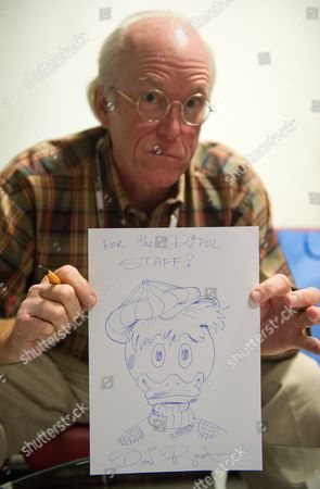 Stock Image of Us Comic Book Writer and Illustrator Keno Don Hugo Rosa Aka Don Rosa Shows One of His Drawings During the 24th International Festival of Comics and Games in Lodz Poland 05 October 2013 the Event Runs Until 06 October Poland Lodz