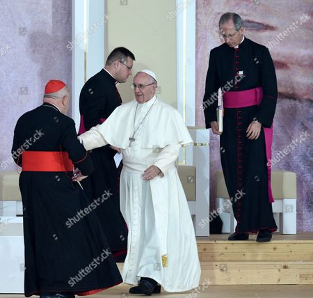 Pope Francis (c) with Master of Pontifical Liturgical Celebrations Guido Marini (r) and Metropolitan of Krakow Cardinal Stanislaw Dziwisz (l) During a Welcome Ceremony at the Blonia Park During the World Youth Day in Krakow Poland 28 July 2016 the World Youth Day 2016 is Held in Krakow and Nearby Brzegi From 26 to 31 July Poland Krakow