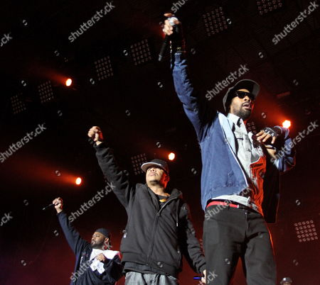 Rappers (l-r): Ghostface Killah (dennis Coles) U-god (lamont Hawkins) and Rza (robert Diggs) of the Us Group Wu-tang Clan Perform During the Concert on a Closing Night of the Coke Live Music Festival in Cracow Poland 10 August 2013 Poland Cracow
