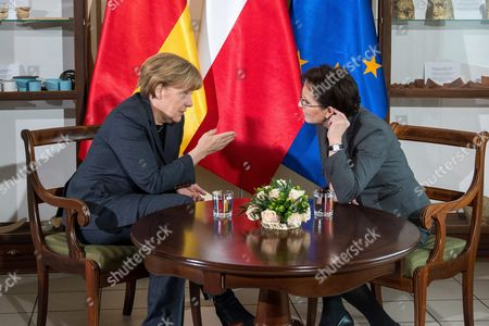 Stock Photo of Polish Prime Minister Ewa Kopacz (r) and German Chancellor Angela Merkel (l) Chat During Their Meeting to Mark the 25th Anniversary of the 1989 Polish-german Reconciliation Mass in Krzyzowa Poland 20 November 2014 on 12 November 1989 Then German Chancellor Helmut Kohl and Polish Prime Minister Tadeusz Mazowiecki Attended a Reconcilement Mass in Krzyzowa Which Symbolised a New Era in German-polish Relations the Cordial Hug of Two Politicians During the Mass Became the Symbol of Polish-german Reconciliation and Changes in Europe Poland Krzyzowa