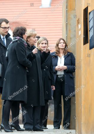 Polish Prime Minister Ewa Kopacz (l) and German Chancellor Angela Merkel (2-l) During a Visit to the 'Courage and Reconciliation' Exhibition Marking the 25th Anniversary of the 1989 Polish-german Reconciliation Mass in Krzyzowa Poland 20 November 2014 on 12 November 1989 German Chancellor Helmut Kohl and Polish Pm Tadeusz Mazowiecki Attended a Reconcilement Mass in Krzyzowa Which Symbolised a New Era in German-polish Relations the Cordial Hug of Two Politicians During the Mass Became the Symbol of Polish-german Reconciliation and Changes in Europe Poland Krzyzowa