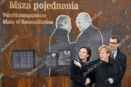 Polish Prime Minister Ewa Kopacz (l) and German Chancellor Angela Merkel (c) During a Visit to the 'Courage and Reconciliation' Exhibition Marking the 25th Anniversary of the 1989 Polish-german Reconciliation Mass in Krzyzowa Poland 20 November 2014 on 12 November 1989 German Chancellor Helmut Kohl and Polish Pm Tadeusz Mazowiecki Attended a Reconcilement Mass in Krzyzowa Which Symbolised a New Era in German-polish Relations the Cordial Hug of Two Politicians During the Mass Became the Symbol of Polish-german Reconciliation and Changes in Europe Poland Krzyzowa
