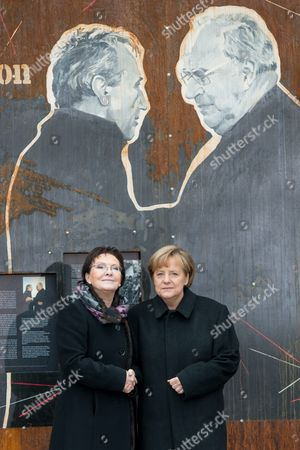 Polish Prime Minister Ewa Kopacz (l) and German Chancellor Angela Merkel (r) During a Visit to the 'Courage and Reconciliation' Exhibition Marking the 25th Anniversary of the 1989 Polish-german Reconciliation Mass in Krzyzowa Poland 20 November 2014 on 12 November 1989 German Chancellor Helmut Kohl and Polish Pm Tadeusz Mazowiecki Attended a Reconcilement Mass in Krzyzowa Which Symbolised a New Era in German-polish Relations the Cordial Hug of Two Politicians During the Mass Became the Symbol of Polish-german Reconciliation and Changes in Europe Poland Krzyzowa