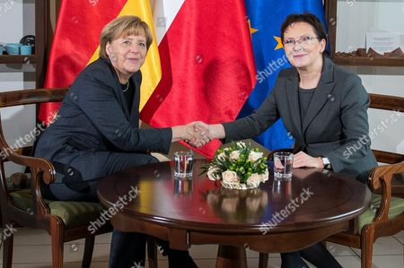 Polish Prime Minister Ewa Kopacz (r) and German Chancellor Angela Merkel (l) Pose For the Media During Their Meeting to Mark the 25th Anniversary of the 1989 Polish-german Reconciliation Mass in Krzyzowa Poland 20 November 2014 on 12 November 1989 Then German Chancellor Helmut Kohl and Polish Prime Minister Tadeusz Mazowiecki Attended a Reconcilement Mass in Krzyzowa Which Symbolised a New Era in German-polish Relations the Cordial Hug of Two Politicians During the Mass Became the Symbol of Polish-german Reconciliation and Changes in Europe Poland Krzyzowa