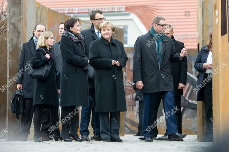 Polish Prime Minister Ewa Kopacz (l) and German Chancellor Angela Merkel (c) During a Visit to the 'Courage and Reconciliation' Exhibition Marking the 25th Anniversary of the 1989 Polish-german Reconciliation Mass in Krzyzowa Poland 20 November 2014 Others Are not Identified on 12 November 1989 German Chancellor Helmut Kohl and Polish Pm Tadeusz Mazowiecki Attended a Reconcilement Mass in Krzyzowa Which Symbolised a New Era in German-polish Relations the Cordial Hug of Two Politicians During the Mass Became the Symbol of Polish-german Reconciliation and Changes in Europe Poland Krzyzowa
