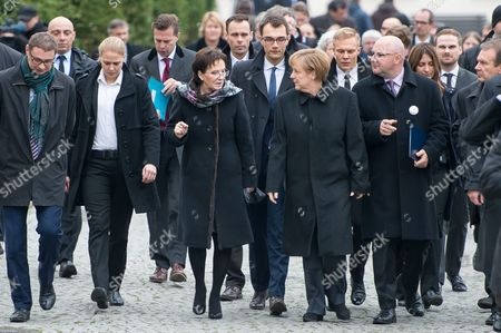Polish Prime Minister Ewa Kopacz (c-l) and German Chancellor Angela Merkel (c-r) During a Visit to the 'Courage and Reconciliation' Exhibition Marking the 25th Anniversary of the 1989 Polish-german Reconciliation Mass in Krzyzowa Poland 20 November 2014 Others Are not Identified on 12 November 1989 German Chancellor Helmut Kohl and Polish Pm Tadeusz Mazowiecki Attended a Reconcilement Mass in Krzyzowa Which Symbolised a New Era in German-polish Relations the Cordial Hug of Two Politicians During the Mass Became the Symbol of Polish-german Reconciliation and Changes in Europe Poland Krzyzowa