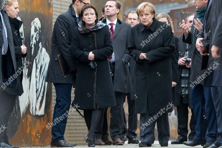 Stock Picture of Polish Prime Minister Ewa Kopacz (c-l) and German Chancellor Angela Merkel (c-r) During a Visit to the 'Courage and Reconciliation' Exhibition Marking the 25th Anniversary of the 1989 Polish-german Reconciliation Mass in Krzyzowa Poland 20 November 2014 Others Are not Identified on 12 November 1989 German Chancellor Helmut Kohl and Polish Pm Tadeusz Mazowiecki Attended a Reconcilement Mass in Krzyzowa Which Symbolised a New Era in German-polish Relations the Cordial Hug of Two Politicians During the Mass Became the Symbol of Polish-german Reconciliation and Changes in Europe Poland Krzyzowa
