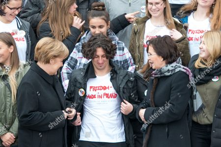 Polish Prime Minister Ewa Kopacz (r) and German Chancellor Angela Merkel (l) Pose For a Family Photo with Polish Students During a Visit to the 'Courage and Reconciliation' Exhibition Marking the 25th Anniversary of the 1989 Polish-german Reconciliation Mass in Krzyzowa Poland 20 November 2014 on 12 November 1989 German Chancellor Helmut Kohl and Polish Pm Tadeusz Mazowiecki Attended a Reconcilement Mass in Krzyzowa Which Symbolised a New Era in German-polish Relations the Cordial Hug of Two Politicians During the Mass Became the Symbol of Polish-german Reconciliation and Changes in Europe Poland Krzyzowa