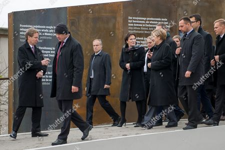 Polish Prime Minister Ewa Kopacz (4-l) and German Chancellor Angela Merkel (4-r) During a Visit to the 'Courage and Reconciliation' Exhibition Marking the 25th Anniversary of the 1989 Polish-german Reconciliation Mass in Krzyzowa Poland 20 November 2014 Others Are not Identified on 12 November 1989 German Chancellor Helmut Kohl and Polish Pm Tadeusz Mazowiecki Attended a Reconcilement Mass in Krzyzowa Which Symbolised a New Era in German-polish Relations the Cordial Hug of Two Politicians During the Mass Became the Symbol of Polish-german Reconciliation and Changes in Europe Poland Krzyzowa