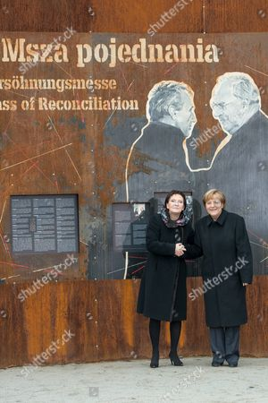 Stock Image of Polish Prime Minister Ewa Kopacz (l) and German Chancellor Angela Merkel (r) During a Visit to the 'Courage and Reconciliation' Exhibition Marking the 25th Anniversary of the 1989 Polish-german Reconciliation Mass in Krzyzowa Poland 20 November 2014 on 12 November 1989 German Chancellor Helmut Kohl and Polish Pm Tadeusz Mazowiecki Attended a Reconcilement Mass in Krzyzowa Which Symbolised a New Era in German-polish Relations the Cordial Hug of Two Politicians During the Mass Became the Symbol of Polish-german Reconciliation and Changes in Europe Poland Krzyzowa