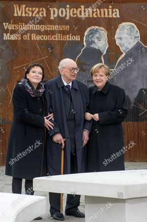 Polish Prime Minister Ewa Kopacz (l) and German Chancellor Angela Merkel (r) with the Polish Prime Minister's Plenipotentiary For International Dialogue Wladyslaw Bartoszewski (c) Pose For a Group Photo During a Visit to the 'Courage and Reconciliation' Exhibition Marking the 25th Anniversary of the 1989 Polish-german Reconciliation Mass in Krzyzowa Poland 20 November 2014 on 12 November 1989 German Chancellor Helmut Kohl and Polish Pm Tadeusz Mazowiecki Attended a Reconcilement Mass in Krzyzowa Which Symbolised a New Era in German-polish Relations the Cordial Hug of Two Politicians During the Mass Became the Symbol of Polish-german Reconciliation and Changes in Europe Poland Krzyzowa