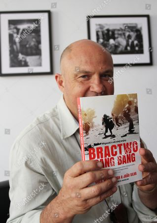 Stock Image of South African Born Photographer Greg Marinovich Poses with His Book 'The Bang-bang Club: Snapshots From a Hidden War' As He Presents His Exhibition 'Warsaw Circus' in Cracow Poland 04 October 2012 Marinovich is a Rsa's Legend of Photojournalism War Photography and Member of the Bang-bang Club He was Awarded the Pulitzer Prize For Spot News Photography in 1991 a Leica Award and a Visa D'or the Exhibition Opens on 04 October Poland Cracow