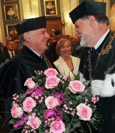 Stock Image of Israeli Nobel Prize in Chemistry Laureate Prof Dan Shechtman (l) Receives a Honorary Degree Doctor Honoris Causa of the Agh University of Science and Technology From Agh Rector Prof Tadeusz Slomka (r) During a Ceremony in Cracow Poland 03 September 2013 Professor Shechtman in 2011 Received the Nobel Prize in Chemistry For 'The Discovery of Quasicrystals' Poland Cracow