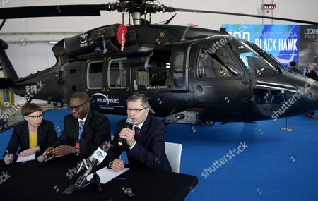 Pzl Mielec Ceo Janusz Zakrecki (r) and Vice President For Operations Strategy in the Sikorsky Company Michael Gordon (c) Attend a Ceremony Marking the Production of the 300th 'Black Hawk' Helicopter Cabin at the Pzl Mielec in Mielec Poland 14 March 2016 the Cabins Which Are Made out of More Than 3 000 Elements Are Produced For the S-70i 'Black Hawk' Helicopters Manufactured in Pzl Mielec and For Other Black Hawk Aircraft Produced at the Sikorsky Aircraft Facilities in the Usa Pzl Mielec is the Largest Polish Aircraft Manufacturer and Largest Lockheed Martin Factory Outside the United States the Facility Produces the International Variant of the Sikorsky Black Hawk Helicopter and the M28 Short Takeoff and Landing Aircraft Poland Mielec