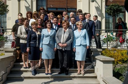 Polish First Lady Anna Komorowska (2-r) and Moldovan First Lady Margareta Timofti (2-l) Pose For a Family Photo After Signing an Agreement on Cooperation Between the Polish Mother Memorial Hospital Research Institute in Lodz and Institute of Mother and Child in Chisinau Ceremony in Lodz Poland 23 April 2015 Poland Lodz