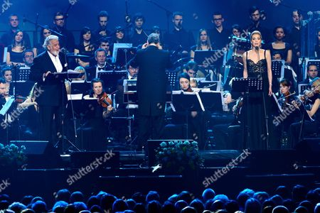 Stock Picture of Spanish Tenor Placido Domingo (l) and Us Soprano Micaela Oeste (r) Perform Onstage During a Special Concert in Poznan Poland 27 April 2014 the Day of the Canonization of Pope John Paul Ii the Polish-born Pontiff Along with Pope John Xxiii Joined the Ranks of Officially-recognized Catholic Saints As Pope Francis Celebrated a Historic Double Canonization Mass in St Peter's Square in the Vatican on 27 April Before Hundreds of Thousands of Pilgrims Poland Poznan