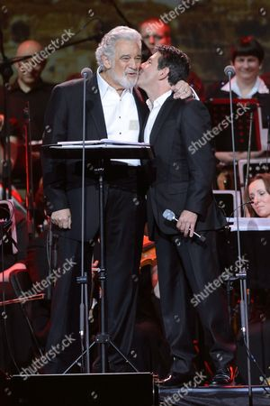 Spanish Tenor Placido Domingo (l) is Kissed by His Son Placido Domingo Jr (r) Onstage During a Special Concert in Poznan Poland 27 April 2014 the Day of the Canonization of Pope John Paul Ii the Polish-born Pontiff Along with Pope John Xxiii Joined the Ranks of Officially-recognized Catholic Saints As Pope Francis Celebrated a Historic Double Canonization Mass in St Peter's Square in the Vatican on 27 April Before Hundreds of Thousands of Pilgrims Poland Poznan