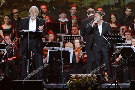 Spanish Tenor Placido Domingo (l) and His Son Placido Domingo Jr (r) Perform Onstage During a Special Concert in Poznan Poland 27 April 2014 the Day of the Canonization of Pope John Paul Ii the Polish-born Pontiff Along with Pope John Xxiii Joined the Ranks of Officially-recognized Catholic Saints As Pope Francis Celebrated a Historic Double Canonization Mass in St Peter's Square in the Vatican on 27 April Before Hundreds of Thousands of Pilgrims Poland Poznan