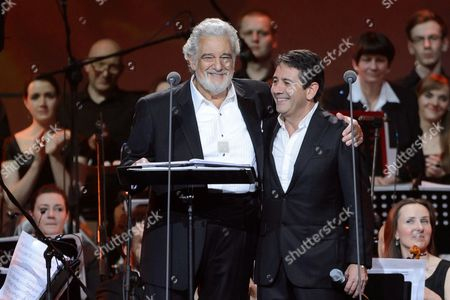 Spanish Tenor Placido Domingo (l) and His Son Placido Domingo Jr (r) Smile Onstage During a Special Concert in Poznan Poland 27 April 2014 the Day of the Canonization of Pope John Paul Ii the Polish-born Pontiff Along with Pope John Xxiii Joined the Ranks of Officially-recognized Catholic Saints As Pope Francis Celebrated a Historic Double Canonization Mass in St Peter's Square in the Vatican on 27 April Before Hundreds of Thousands of Pilgrims Poland Poznan