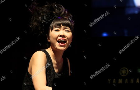 Stock Picture of Japanese Jazz Pianist and Composer Hiromi Uehara Performs on Stage During Her Concert in Gorzow Wielkopolski Poland 05 April 2014 Poland Gorzow Wielkopolski