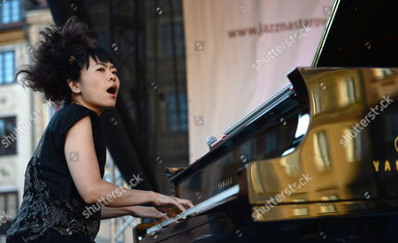 Japanese Pianist Hiromi Uehara of Hiromi the Trio Project Performs During a Concert at the Summer Jazz Festival 'Jazz Na Starowce' on the Old Town Market Square in Warsaw Poland 20 July 2013 Poland Warsaw