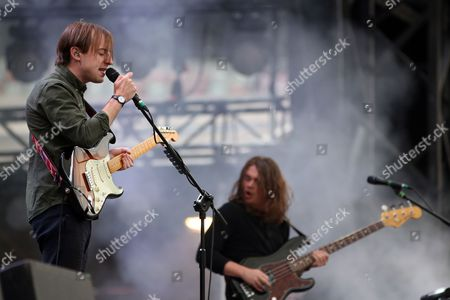 Frontman Jack Steadman (l) and Bass Guitarist Ed Nash (r) From British Band Bombay Bicycle Club Perform on Stage During the Orange Warsaw Festival 2014 at the National Stadium in Warsaw Poland 14 June 2014 the Event Runs From 13 to 15 June Poland Warsaw